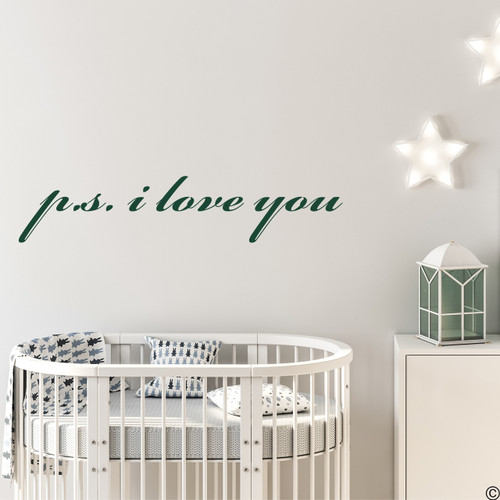 The p.s. i love you wall decal quote in the dark green vinyl color and on the wall in a nursery room.