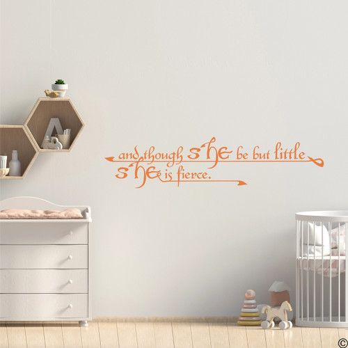 """A Shakespeare wall decal quote of """"And though she be but little, she is fierce."""" Applied to a little girl's nursery room wall with the persimmon vinyl color."""