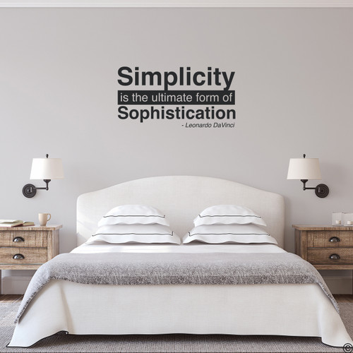 "A famous Leonardo DaVinci wall decal quote of ""Simplicity is the ultimate form of Sophistication."" Shown here in black vinyl and with modern bedroom home decor."