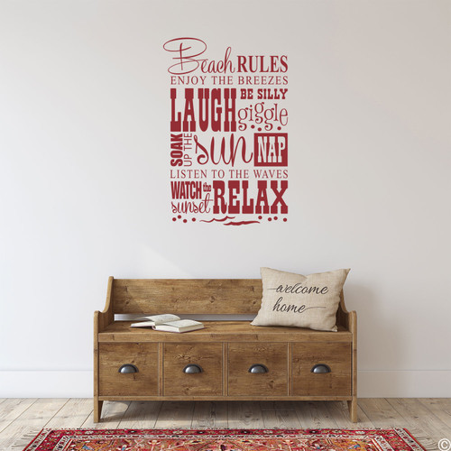 The Beach Rules wall decal on a wall in the dark red vinyl color.