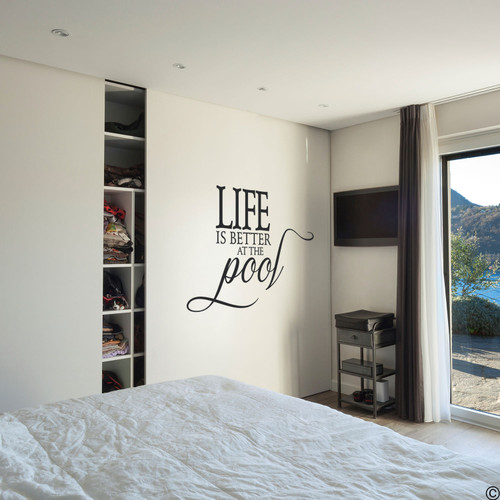 The Life is better at the Pool wall decal, on a bedroom wall in the black vinyl color.