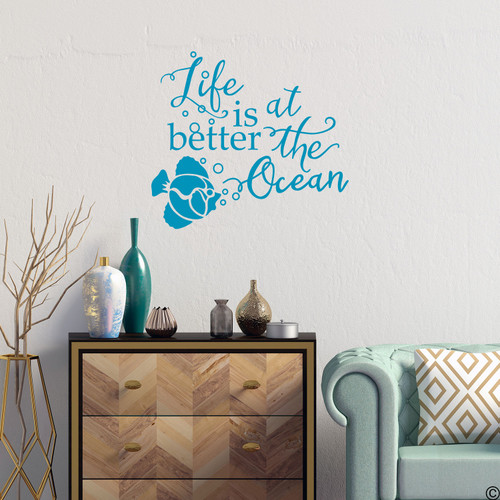 "Fish wall decal with ""Life is better at the Ocean,"" quote. Shown here in teal color."