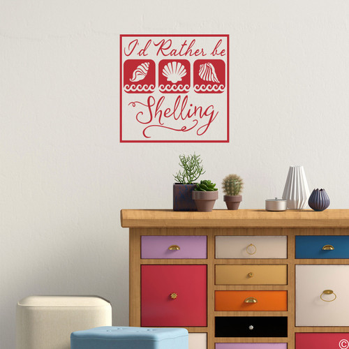 """""""I'd Rather Be Shelling,"""" wall decal quote with seashell images. Shown here in red color."""