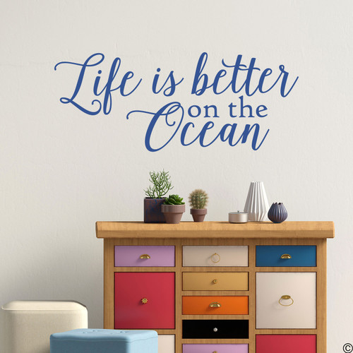 """Wall decal quote of """"Life is better on the ocean."""" Shown here in the limited edition denim vinyl color."""