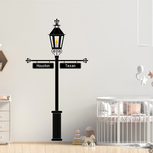 The Gas Lamp wall decal with customizable signs on a nursery wall in black vinyl.