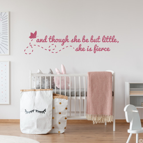 """Flying butterfly with a Shakespeare wall decal quote of """"and though she be but little, she is fierce."""" Applied here to a little girl's nursery room wall in the lipstick vinyl color."""