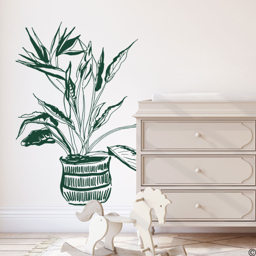 The hand drawn Bird of Paradise potted plant wall decal in the dark green vinyl color.