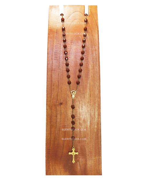 Brown Rosary with Golden Crucifix displayed in wooden necklace hanger.