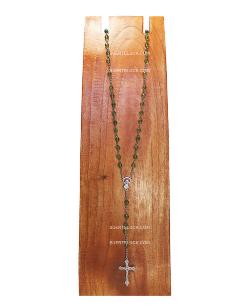 Clear Green Rosary with Stainless Steel Crucifix displayed on wooden board