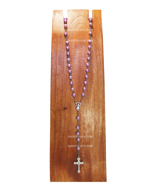 Light Purple Rosary with Stainless Steel Crucifix  displayed on a wooden board.