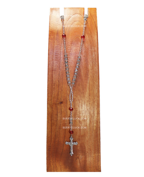 Clear and Red Rosary with a Stainless Steel Crucifix displayed on a wooden necklace hanger.