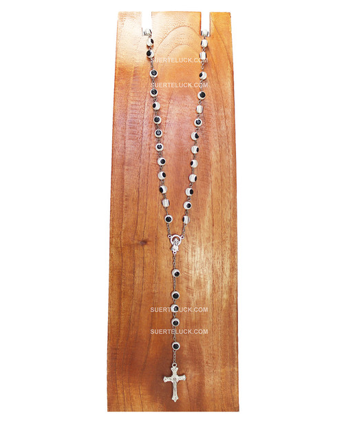 White and Black Evil Eyes Rosary Necklace with Stainless a Steel Crucifix displayed in a wooden necklace hanger.