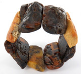 LARGE / VINTAGE ROUGH CUT AMBER BANGLE. 97.8 GRAMS.