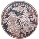 "1987 ""HAPPY HOLIDAYS"" .999% FINE SILVER 1oz 31.1g TRADE UNIT / ROUND."