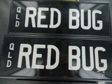 RARE QUEENSLAND REGO NUMBER PLATE  RED BUG  NEVER FITTED NEAR MINT, FRONT & BACK