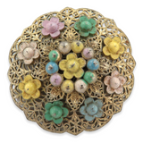 VINTAGE LARGE FLORAL THEME CONVEX SHAPED COSTUME BROOCH.