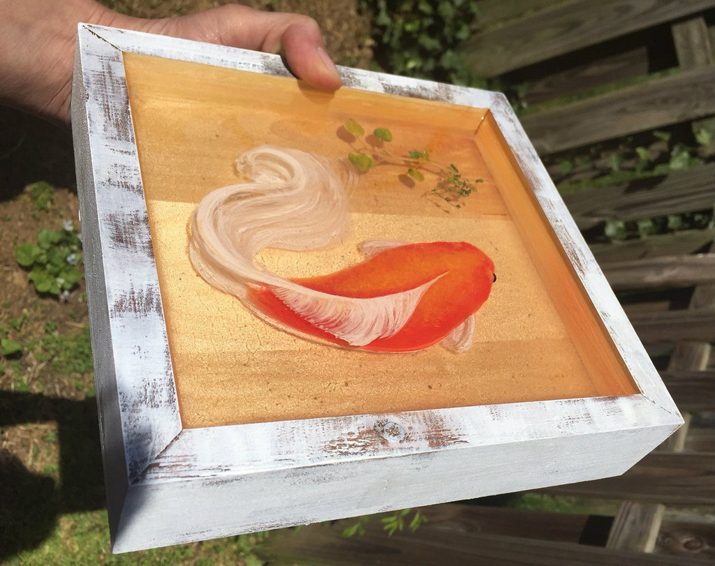 "8"" x 8"" x 1"" hand painted layers of acrylic in between alternating layers of resin."