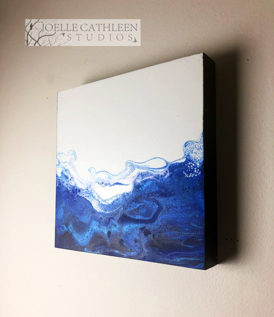 Side view of a Finished Fluid Art Painting on Wooden Cradled Panel