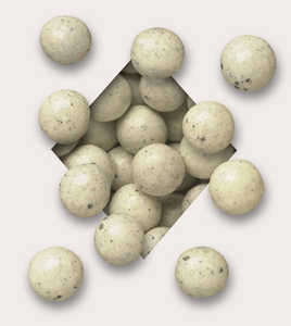 Cookies & Cream Malted Milk Balls: Like a delicious after school snack, our malt balls are first wrapped in milk chocolate then coated in a smooth white chocolate coating with ground cookies. There are approximately 38 pieces per 1/2 pound & 77 pieces per pound.