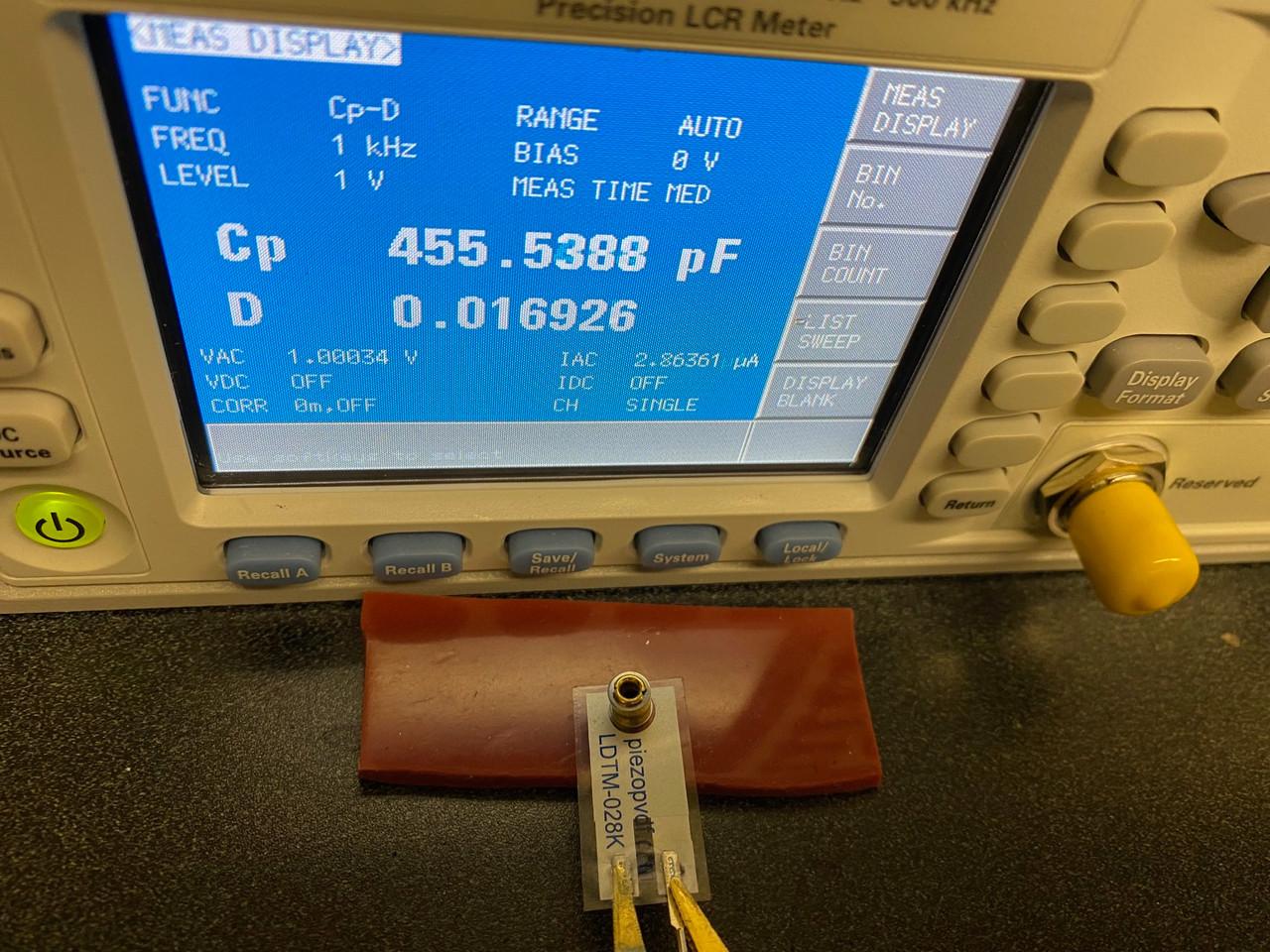 Piezoelectric PVDF Vibration Sensor With Mass