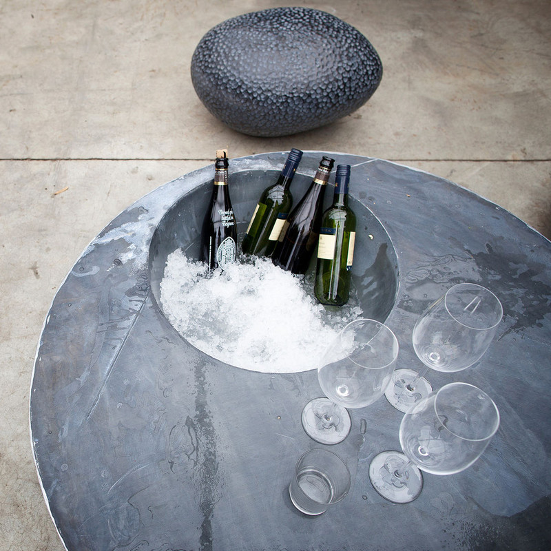ZINC COOL TABLE Our 'cool table' is an oval zinc side table. With its built in cooling space it's the ideal party table. Prepare the ice for your apertitif and things can't go wrong. No stress for the host and hostess, because cool drinks are within reach. Cool table also makes an exellent breakfast table.