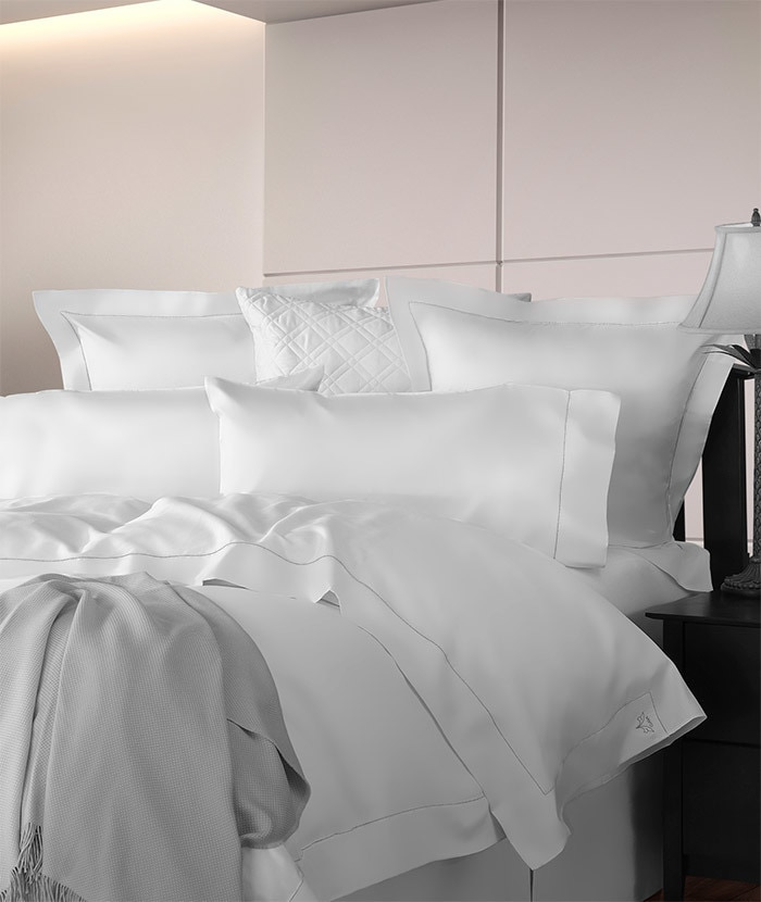 Diamante luxury bedding. 600 thread count solid sateen. Woven and sewn in Italy. Available in white, ivory & sable (medium tan).