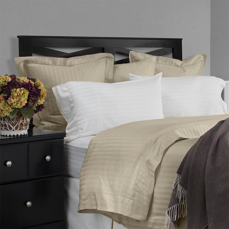 Pillow shams are an excellent way to finish off the look of your bed. Righetta is a tone on tone classic tuxedo stripe and pairs wonderfully with our solid or other Righetta fabrics.  Available in white, ivory and sable.
