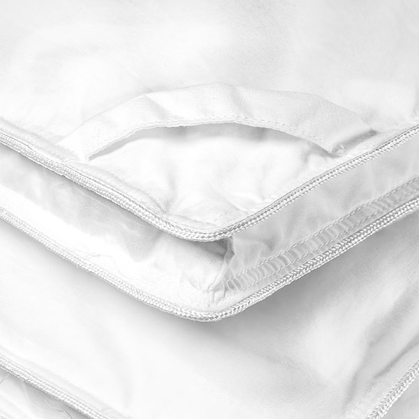 All our down comforters are made with a sewn in loop at the corners of the comforter to eliminate slipping when attached to the inside of the duvet cover.