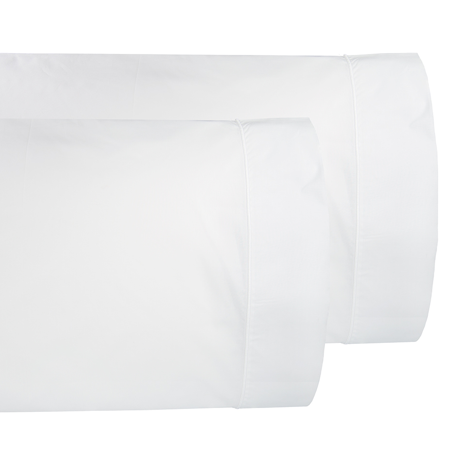 Luxurious Percale pillowcases, made from the finest cotton, generously sized and elegantly appointed with a single line of embroidery on the pillowcases and flat sheets. Shown here is our white pillowcases with white embroidery.