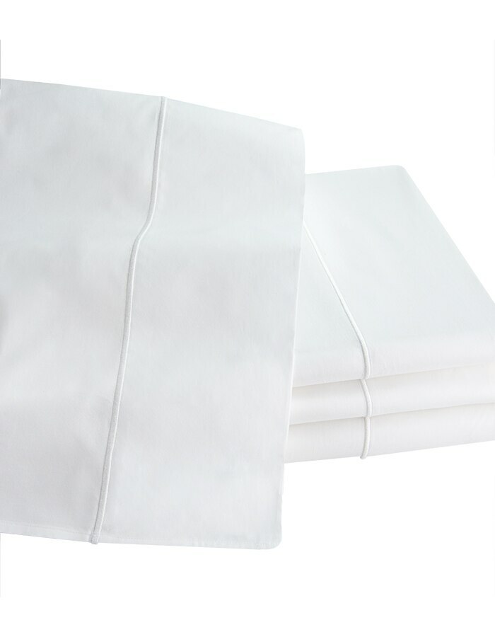 Olivia fitted sheets pair perfectly with  Olivia flat sheets and pillowcases are made with a single line of embroidery on the flat sheets flange and pillowcase cuff.