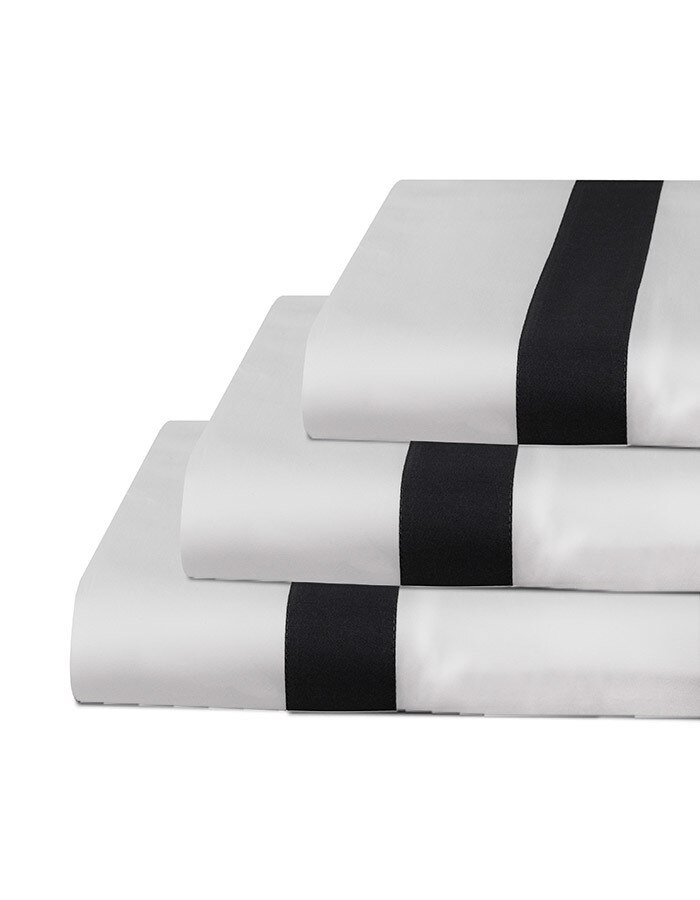 Shown here are our luxury Ava percale flat sheets. Ava is produced in Italy & made from the finest grades of cotton. The charcoal appliqué adds a handsome detail and style to the flat sheets, pillowcases and duvet covers. Ava offers that crisp, smooth and velvety soft feel next to the skin.