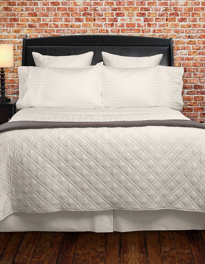 Luxury Quilted Coverlets, available in white, ivory & sable.
