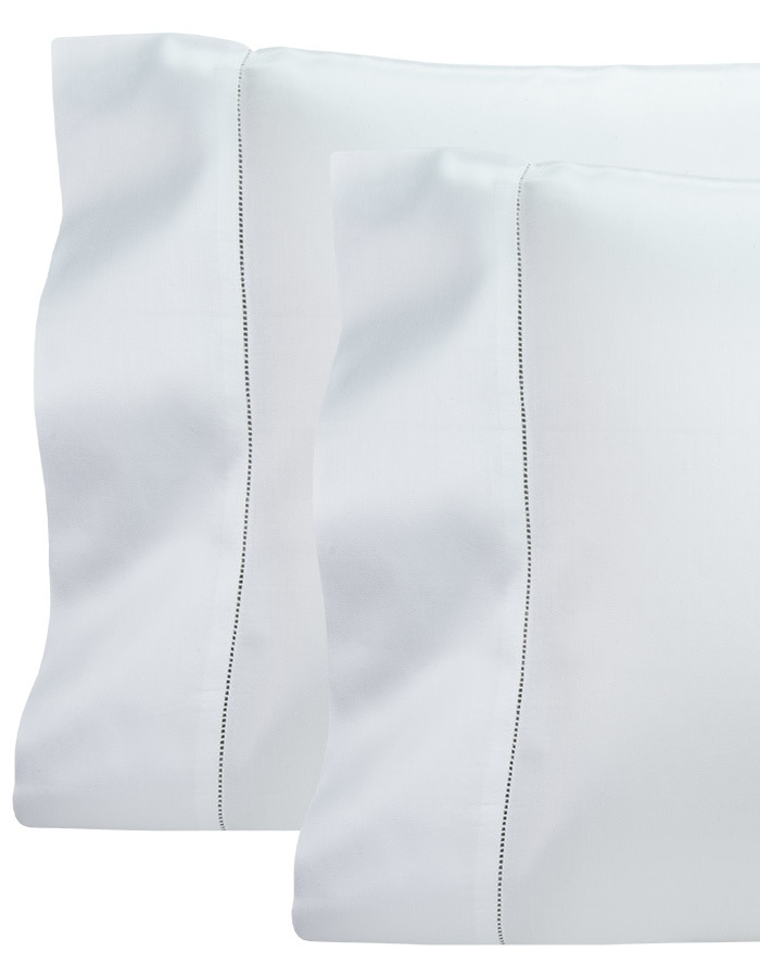 Produced in Italy from 100% long staple cotton. Woven in a solid sateen. Finished with an elegant hemstitch detail.