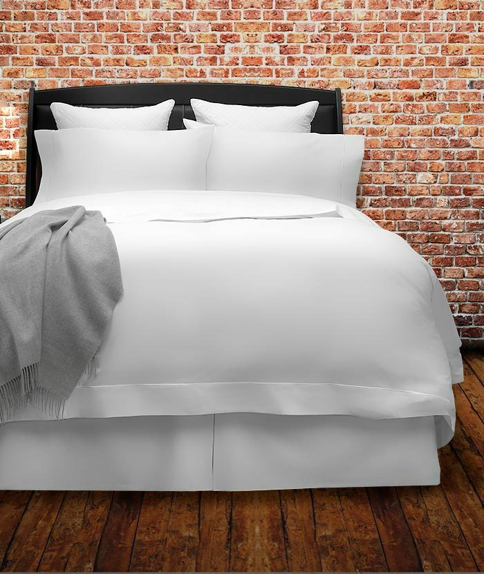 Olivia luxury bedding shown on a bed
