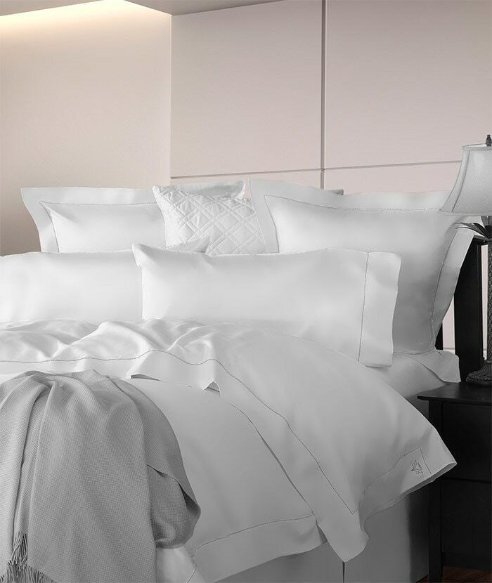 Diamante bedding shown in white on a bed