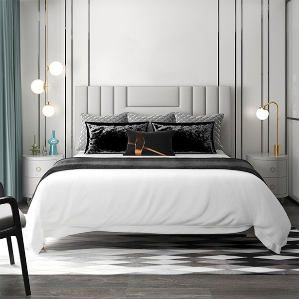 Olivia all white with white embroidery bedding shown on a bed
