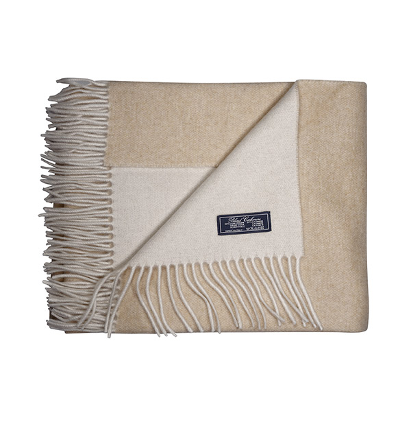 "Shown here is our camel/ivory throw. made from 80% virgin Merino wool and 20% Cashmere. Generously sized at 50"" x 70""."
