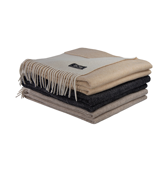 Luxury Wool and Cashmere blend throws. Soft and cozy, the accessory thing to cuddle with place at the foot of the bed, chair or couch. Available in Camel, Flax and Grey.