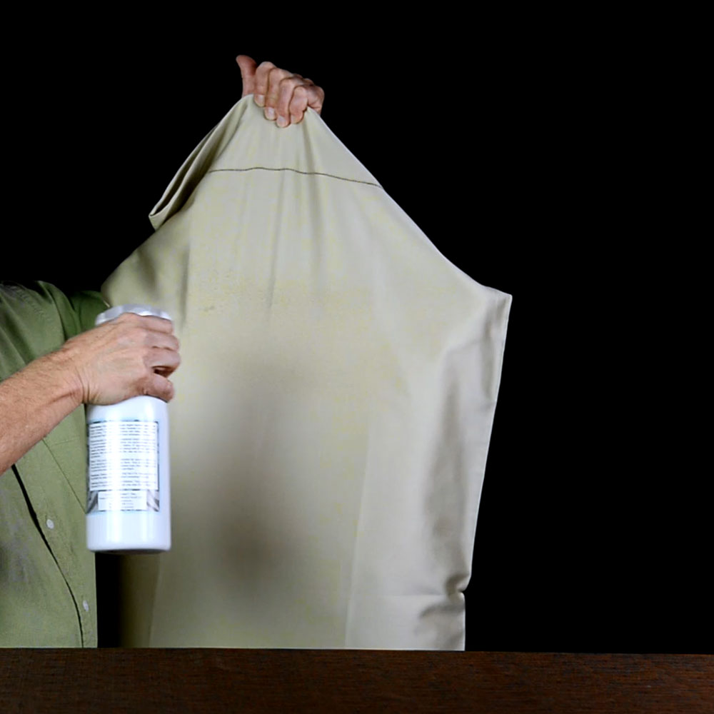 Spray pillowcases with water