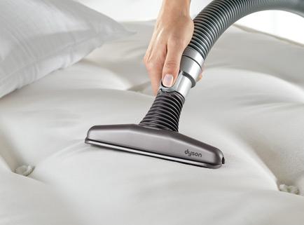 Vacuuming baking soda off the mattress