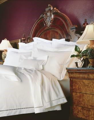 Shown here is an elegant all white bed