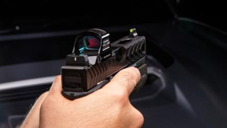 DXT2 Standard dot green, suppressor rmr height with an RDO on a glock