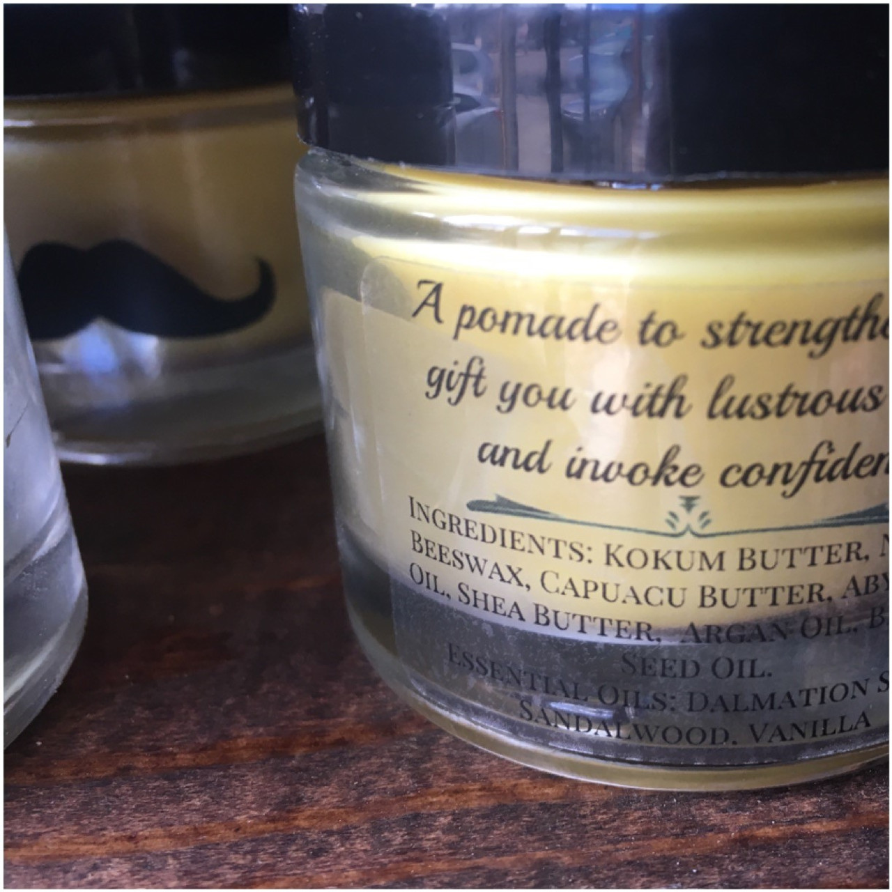 Mustache pomade, hair pomade, curl nourishment, A Pomade For The People. Ingredients: Kokum Butter, Unrefined Beeswax, Capuacu Butter, Argan Oil, Unrefined Shea Butter, Abyssinian Oil, Buriti Oil,Brocolli Seed Oil, Essential Oils of: Sage, Sandalwood, Vanilla