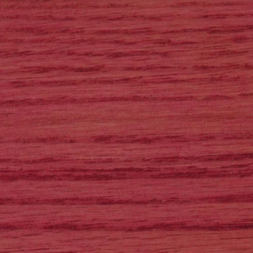 A sample of the Saman raspberry colored stain on wood.