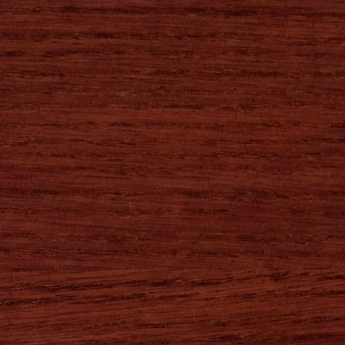 Saman mahogany stain shown on a after being applied to a board.