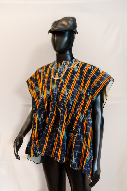 Batakari is a mixture of dyed and undyed cotton loom, and are originally from the northern part of Ghana and other parts of West Africa. The strips are sewn together by hand or machine giving the smock a plaid appearance. Most smocks have embroidery on the neckline. (Streetmarketafrica.com)
