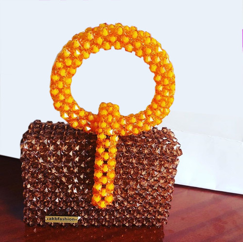 This Bag is handmade with high quality glass bead. Durable & firm to carry items put in Strong handle to hold bag firm Authentic & can withstand all weather conditions.