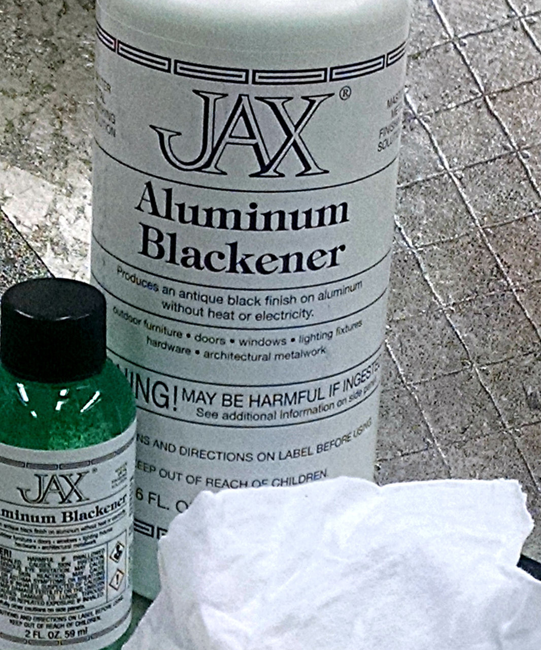 Aluminum Blackener  on Aluminum  over black ground.