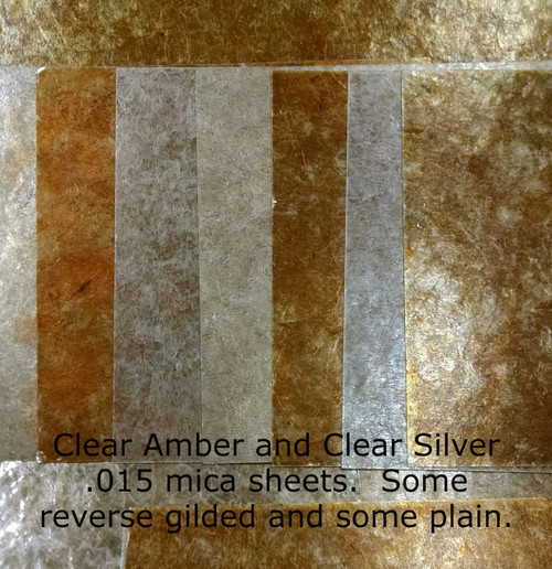Assorted mica sheeting, reverse silvered, reverse gilded, clear natural amber, clear natural silver.
