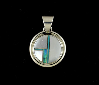 Sterling silver pendant in mother of pearl and created opal. Authentic American Indian jewelry handcrafted by Navajo artists. Chain not included.